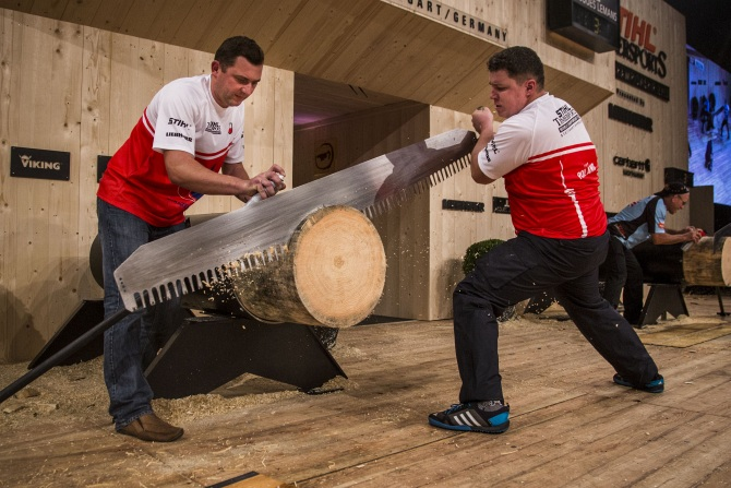 Arkadiusz Drozdek of Poland performs during the Single Championship of the Stihl Timbersports World Championship 2013 at the Porsche Arena in Stuttgart, Germany