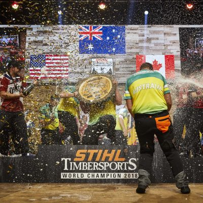 Team Australia celebrates with Team United States and Team Canada during the Award Ceremony of the STIHL TIMBERSPORTS® Team World Championship at the Echo Arena in Liverpool, Great Britain on October 19, 2018.
